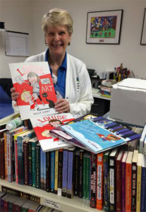 Distributing books given to our young patients by famous authors and illustrators!